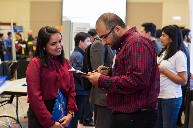 Two people speaking at a career fair
