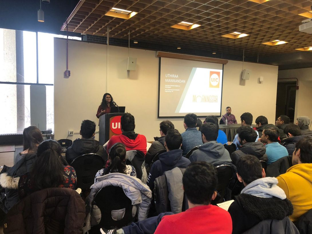 Group of international students listening to a presentation from a UIC alum